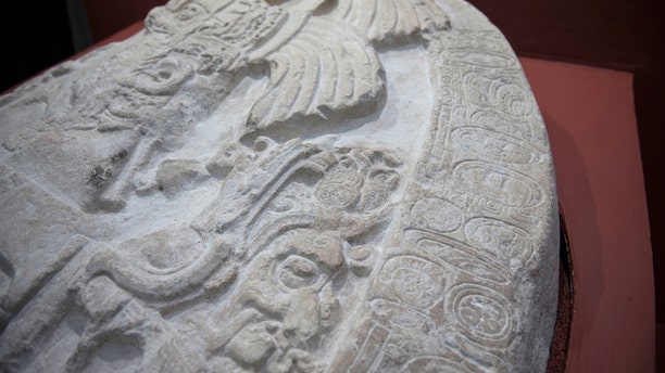 """A nearly 1,500-year-old carved altar from the Maya site """"La Corona,"""" located in the northern Guatemalan department of Peten, is displayed at the National Museum of Archaeology and Ethnology in Guatemala City, Wednesday, Sept. 12, 2018. (AP Photo/Oliver de Ros)"""