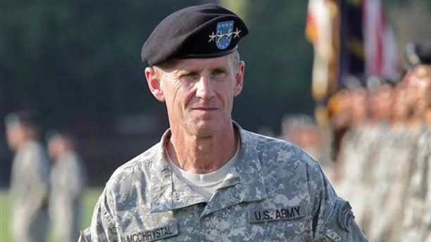 FILE - This July 23, 2010, file photo shows Gen. Stanley McChrystal reviewing troops for the last time as he is honored at a retirement ceremony at Fort McNair in Washington. Speaking out for the first time since he resigned, retired Gen. Stanley McChrystal writes in a new memoir that he takes the blame for the Rolling Stone article that ended his Afghan command and army career, including for the unflattering comments attributed to his staff about the Obama administration. (AP Photo/J. Scott Applewhite, file)