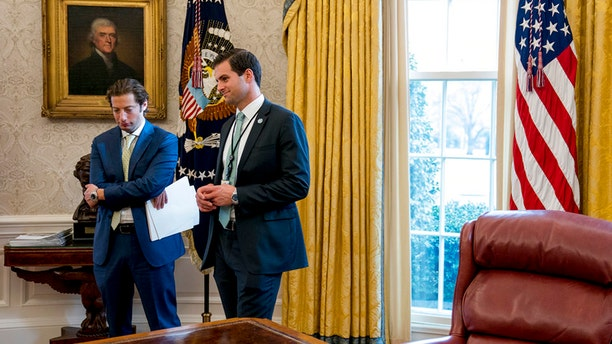 John McEntee, right, a former UConn quarterback who serves as the president's personal aide, was ousted from his official job, given a new job with the Trump campaign and escorted from the White House under mysterious circumstances.