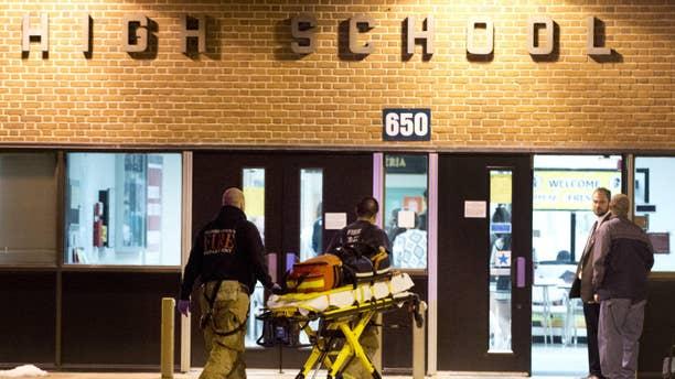 Feb. 4, 2015: Officials enter Frederick High School.