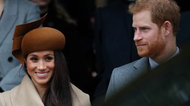 Britain's Prince Harry and his fiancee Meghan Markle leave St Mary Magdalene's church after the Royal Family's Christmas Day service on the Sandringham estate in eastern England, Britain, December 25, 2017. REUTERS/Hannah McKay - RC18CBCBC800
