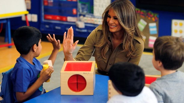 First Lady Melania Trump with children at the American International School of Riyadh, Saudi Arabia in May 2017.