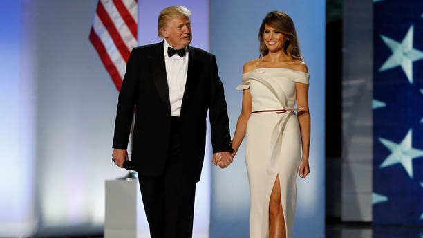 FILE -- President Donald Trump and first lady Melania Trump arrive at the Inauguration Freedom Ball in Washington, U.S., January 20, 2017.