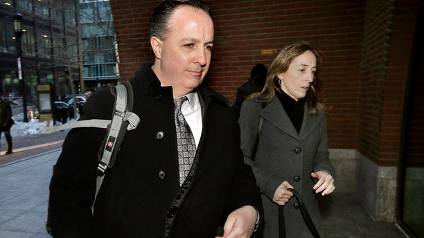 Barry Cadden, center, arrives at the federal courthouse, Thursday, March 16, 2017, in Boston, before scheduled closing arguments in his trial. Cadden, a former pharmacy executive and the president of New England Compounding Center, is charged with causing the deaths in 2012 of 25 people who received tainted steroids manufactured by the pharmacy. (AP Photo/Steven Senne)