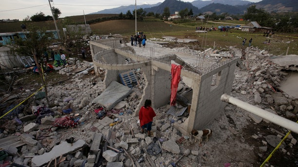 Residents stand next debris after fireworks stored in a house exploded in San Isidro, Chilchotla, Mexico May 9, 2017. REUTERS/Imelda Medina - RTS15UU2
