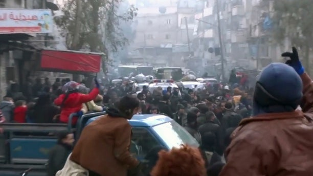 This frame grab from video provided by Baladi News Network, a Syrian opposition media outlet that is consistent with independent AP reporting, shows civilians gathering for evacuation from eastern Aleppo, Syria, Thursday, Dec. 15, 2016.