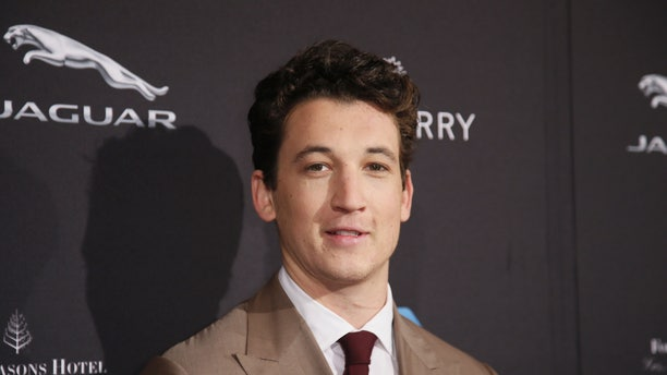 January 10, 2015. Miles Teller poses at the British Academy of Film and Television Arts (BAFTA) Los Angeles 2015 Awards season tea party in Beverly Hills, California.