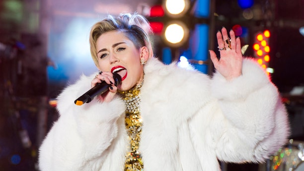 Dec 31, 2013.  Miley Cyrus performs in Times Square during New Year's Eve celebrations in New York. Cyrus is kicking off her North American Bangerz tour Feb. 14, 2014, in Vancouver.