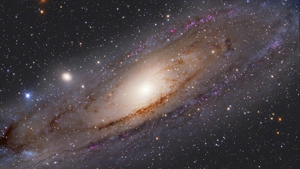 The Andromeda galaxy, with satellite galaxies M32 (center left) and M110 (lower right). A new study suggests that M32 is the remnant of a much larger galaxy gobbled up by Andromeda about 32 billion years ago. Credit: S. Ozime