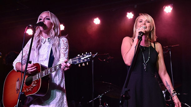 Ashley Monroe (left) claims Miranda Lambert (right) didn't like her when they first met.