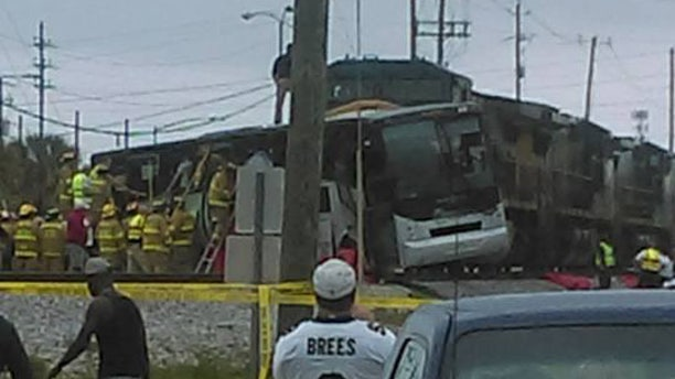 At least 4 people were killed when a CSX freight train hit a charter bus in Biloxi, Mississippi