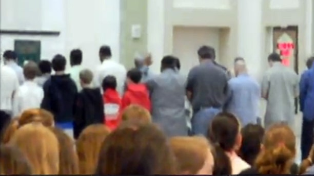 May 27, 2010: Video shot by a parent during a Wellesley Middle School field trip shows five sixth-grade boys, left, engaging in a prayer ritual at Islamic Society of Boston Community Center.