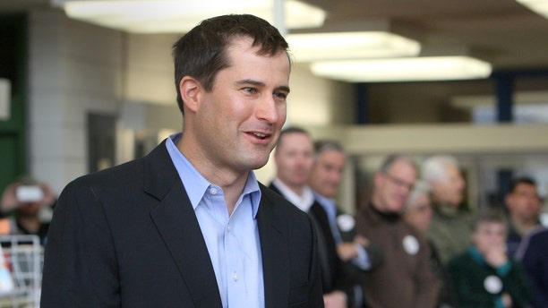 FILE: Seth Moulton speaks at a Democratic caucus in the library of Salem High School in Salem, Mass.