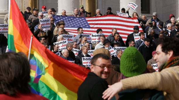 Nov. 19, 2014: Supporters of Arkansas' law banning same sex marriage, top, hold a rally at the Arkansas state Capitol in Little Rock, Ark.,