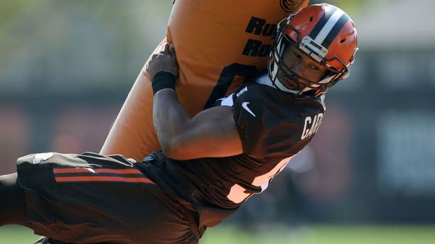 BEREA, OH - MAY 13, 2017: Defensive end Myles Garrett #95 of the Cleveland Browns takes part in a tackling drill during a rookie mini camp practice on May 13, 2017 at the Cleveland Browns training facility in Berea, Ohio. 17-05136945 2017 Nick Cammett/Diamond Images/Getty Images