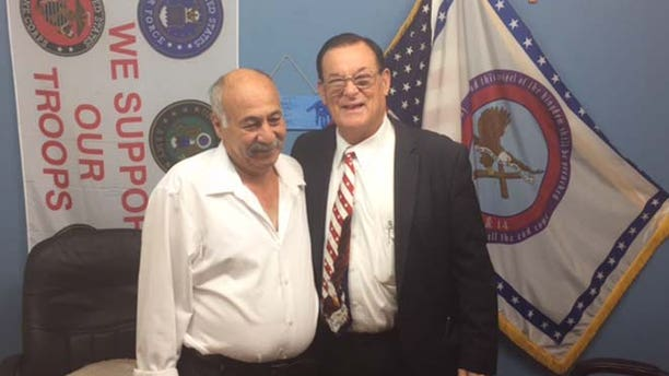Nakoula, seen here with the Rev. Wiley S. Drake, lives in a homeless shelter.