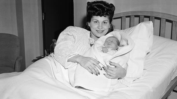 In this Jan. 10, 1944 file photo, Nancy Sinatra holds her newborn son, Frank, at Margaret Hague Maternity Hospital in Jersey City, N.J.