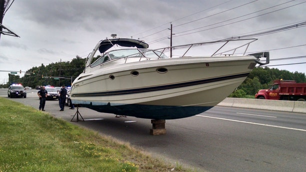 Police found a 37-foot boat on the side of Route 1 in South Brunswick, New Jersey.