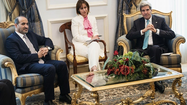 June 27, 2014: Syrian opposition leader President Ahmad al-Jarba, left, and U.S. Secretary of State John Kerry wait prior to a meeting at King Abdulaziz International Airport in Jeddah, Saudi Arabia. (AP)