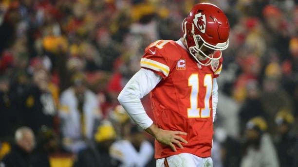 Jan 15, 2017; Kansas City, MO, USA; Kansas City Chiefs quarterback Alex Smith (11) reacts during the second quarter against the Pittsburgh Steelers in the AFC Divisional playoff game at Arrowhead Stadium. Mandatory Credit: Jeff Curry-USA TODAY Sports