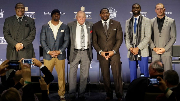 Former NFL players Robert Brazile, from left, Brian Dawkins, Bobby Beathard, Ray Lewis, Randy Moss, and Brian Urlacher who will be inducted into the Pro Football Hall of Fame class of 2018, attend the 7th Annual NFL Honors at the Cyrus Northrop Memorial Auditorium on Saturday, Feb. 3, 2018, in Minneapolis.