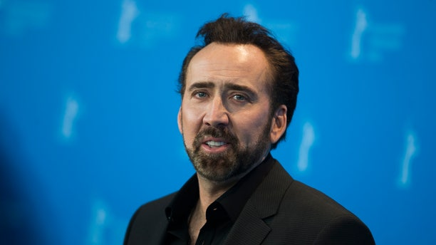 """Nicolas Cage, the voice of the character Grug, poses during a photocall promoting the animation movie """"The Croods"""" at the 63rd Berlinale International Film Festival in Berlin February 15, 2013. REUTERS/Thomas Peter  (GERMANY  - Tags: ENTERTAINMENT) - RTR3DU1U"""