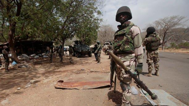 Nigerian soldiers man a checkpoint in Gwoza, Nigeria.