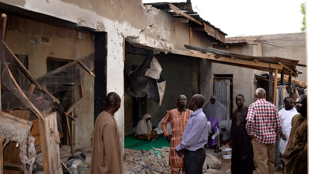 May 31, 2015: People inspect houses damaged damaged in Saturday's rocket propelled grenades by Islamic extremist in Maiduguri, Nigeria.
