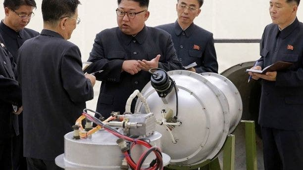 Kim Jong Un was pictured in September with what appeared to be a nuclear device after the Hermit Kingdom's sixth nuclear test.