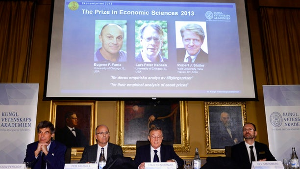 Oct. 14, 2013: The Royal Swedish Academy of Sciences Torsten Persson, from left, Per Krusell, Staffan Normark and Per Stromberg announce the winners of 2013 Nobel Memorial Prize in Economic Sciences as Eugene Fama, Lars Peter Hansen and Robert Shiller during a press conference at the Royal Swedish Academy of Sciences in Stockholm.