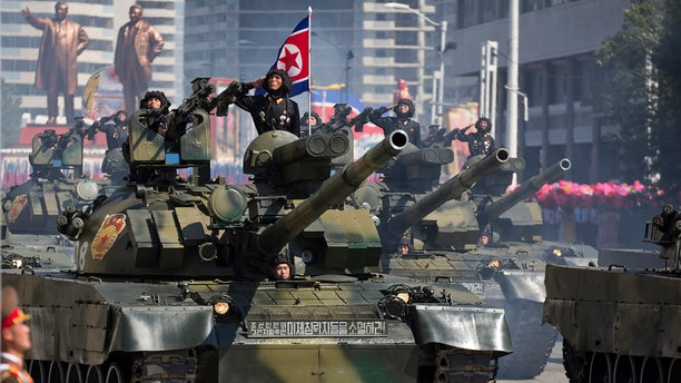 Tanks roll past during a parade for the 70th anniversary of North Korea's founding day in Pyongyang, North Korea, Sept. 9, 2018.