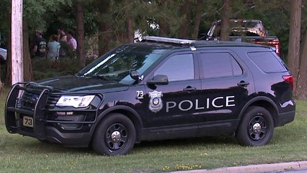 Police in North Royalton, Ohio, at the scene of a triple homicide Monday.