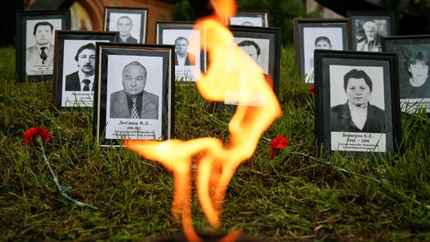 """Portraits of """"liquidators"""", emergency workers who fought the blaze at the Chernobyl nuclear reactor, are seen during a commemoration ceremony in Kiev, Ukraine, April 26, 2016.  REUTERS/Gleb Garanich - RTX2BPDA"""