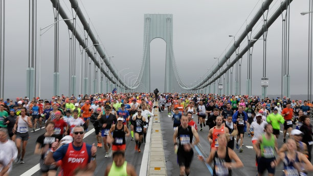The first wave of runners make their way across the Verrazano-Narrows Bridge during the start of the New York City Marathon in New York, U.S., November 5, 2017.
