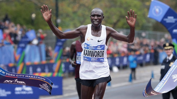 Geoffrey Kamworor of Kenya crosses the finish line first in the men's division of the New York City Marathon in New York, Sunday, Nov. 5, 2017.