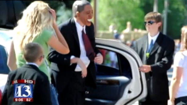 An actor posing as President Obama is shown at a parade in Huntsville, Utah.