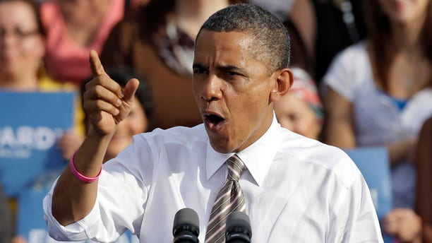 Oct. 25, 2012: President Obama gestures while speaking at a campaign event at Ybor Centennial Park in Tampa, Fla.
