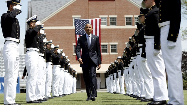 President Obama walks through an honor cordon as he arrives for  the 134th Commencement Exercises of the United States Coast Guard Academy in New London, Ct.