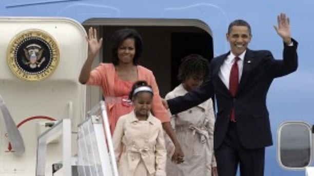 President Barack Obama, right, his daughters Malia, second right, and Sasha and his wife Michelle Obama are seen on their arrival at Moscow's Vnukovo airport, Russia, Monday, July 6, 2009. Presidents Barack Obama and Dmitry Medvedev end a seven-year hiatus in U.S.-Russian summitry on Monday, with each declaring his determination to further cut nuclear arsenals and repair a badly damaged relationship. (AP Photo/Mikhail Metzel)