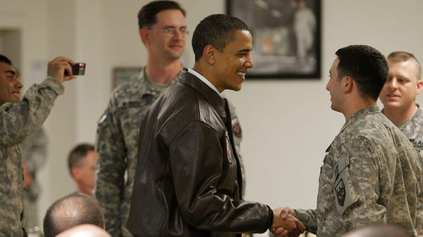 President Barack Obama greets military personnel in Dragon dining facility at Bagram Air Base in Afghanistan, Monday, March 29, 2010. (AP Photo/Charles Dharapak)
