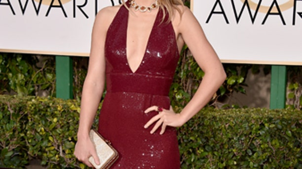 Olivia Wilde arrives at the 73rd annual Golden Globe Awards on Sunday, Jan. 10, 2016, at the Beverly Hilton Hotel in Beverly Hills, Calif. (Photo by Jordan Strauss/Invision/AP)