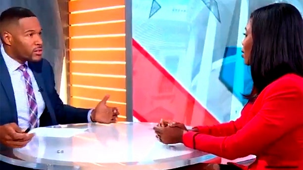 Strahan, left, landed the interview with Omarosa, but his co-host seemed unimpressed