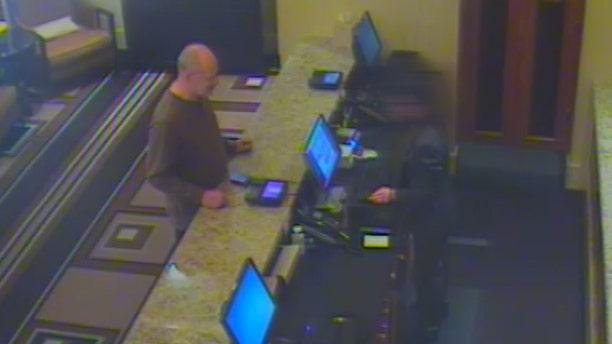 Las Vegas shooter Stephen Paddock checking into the Mandalay Bay Resort and Casino.
