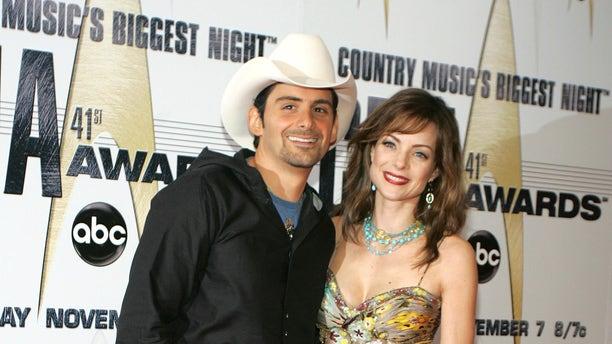 November 7, 2007. Singer Brad Paisley and his wife, actress Kimberly Williams-Paisley, pose as they arrive at the 41st annual Country Music Awards in Nashville, Tennessee.