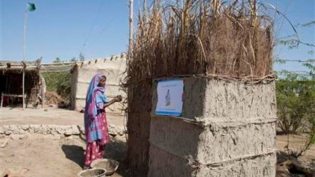 March 3, 2015: In this photo, a Pakistani villager builds a toilet in Thatta district, Sindh province, 62 miles southeast of Karachi, Pakistan.