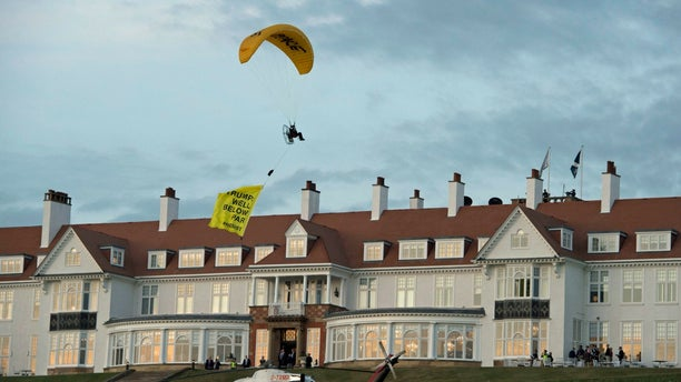 Scottish police are searching for a protester who breached a no-fly zone after paragliding over President Trump's golf resort.