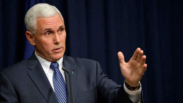 March 26, 2015: Indiana Gov. Mike Pence holds a news conference at the Statehouse in Indianapolis.