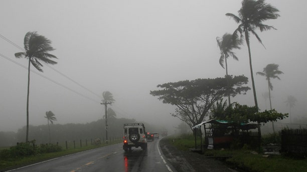 Aug. 27: Motorists drive on a highway in Batangas, south of Manila, Philippines, under a dense fog and rain brought about by typhoon Nanmadol.