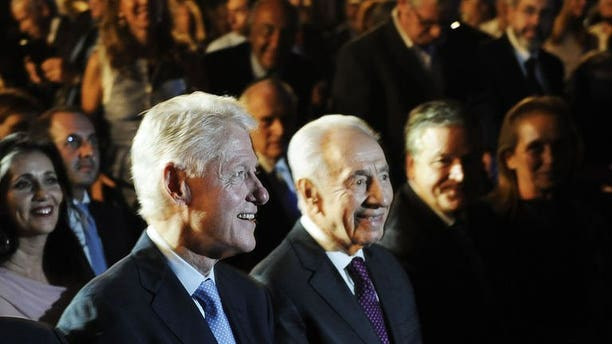 "Former US president Bill Clinton (L) and Israeli President Shimon Peres arrive on June 17, 2013 at the Peres Academic Center (EAC) in Rehovot. Clinton told the crowd at the event celebrating Peres' upcoming 90th birthday that he sees ""no alternative"" to a Palestinian state."