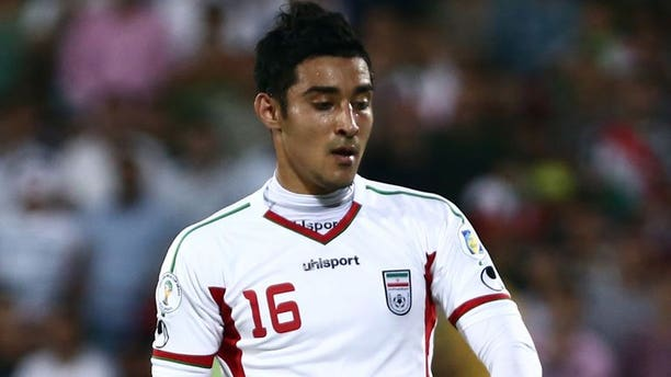 Iranian forward Reza Ghoochannejhad plays during a 2014 World Cup Asian zone match at Azadi Stadium in Tehran on June 11, 2013. Iran beat South Korea 1-0 to reach the 2014 World Cup but the hosts also qualified on goal difference despite a heroic effort by group rivals Uzbekistan.